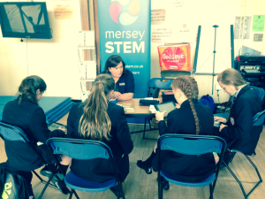 Angela discussing STEM opportunities with the young people of Deyes High School